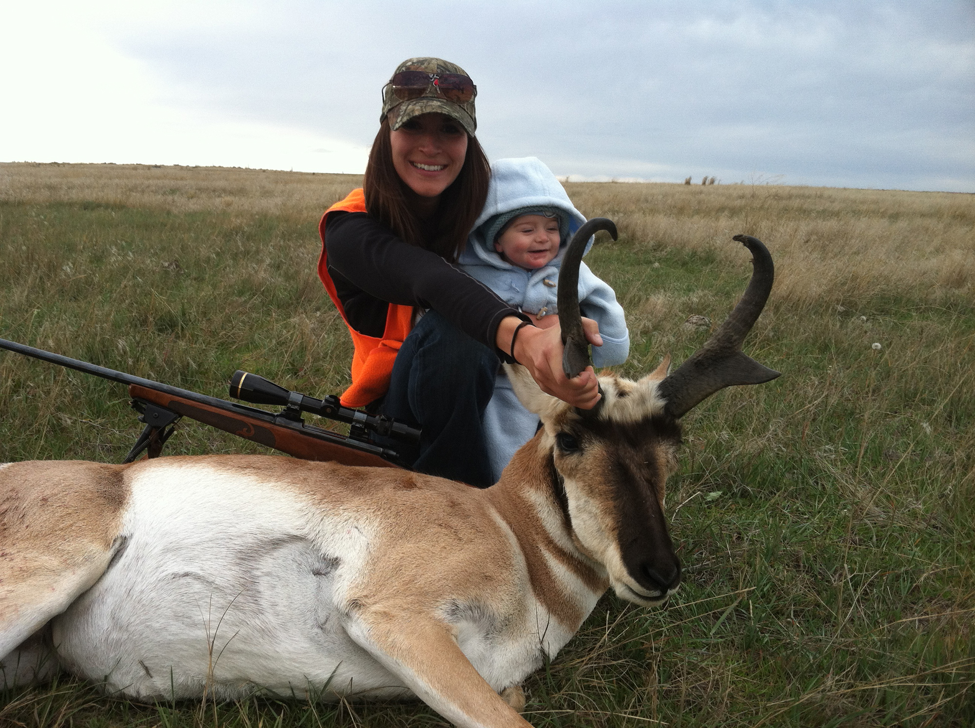 Jaimie and her son after a successful antelope hunt.