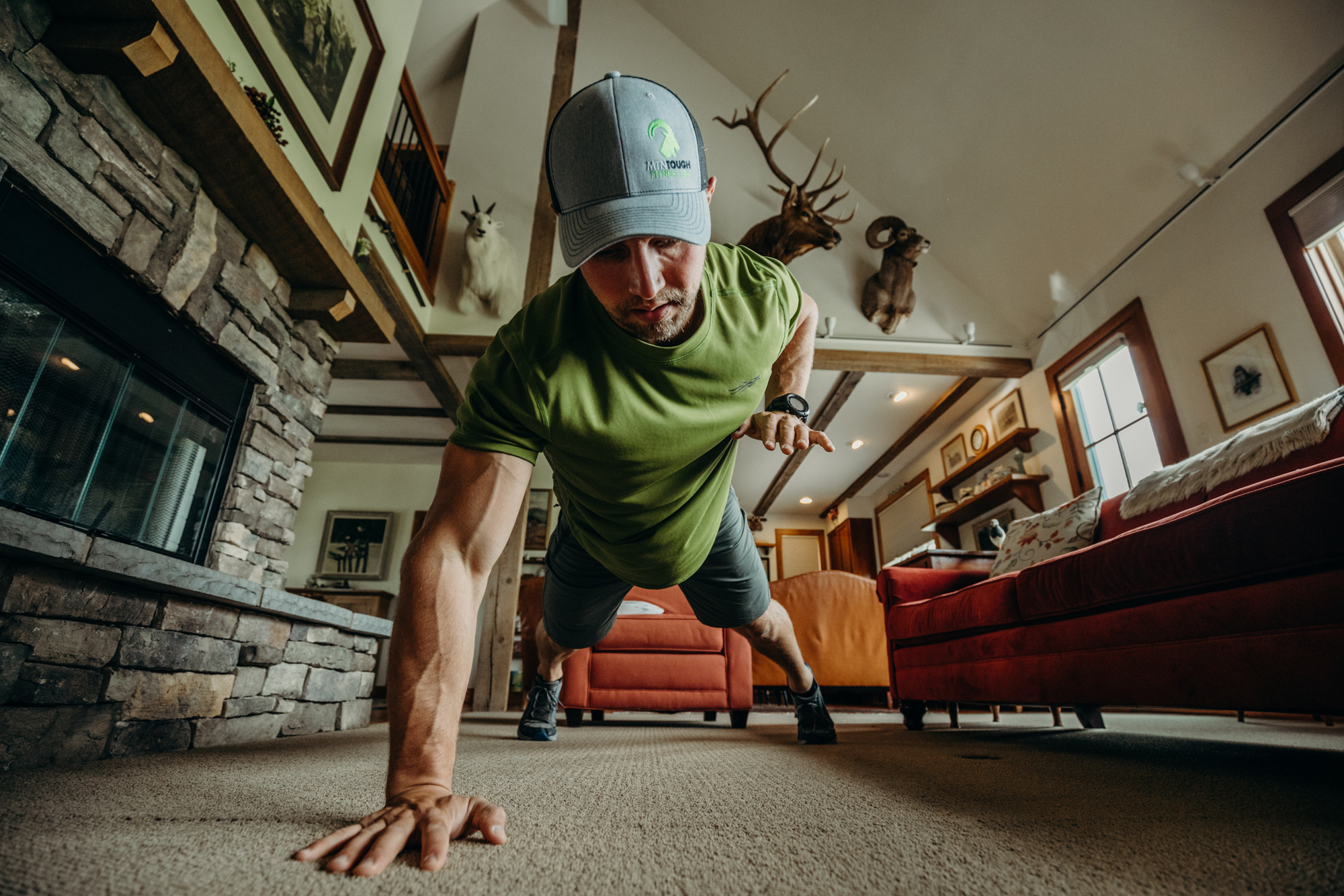 Man does push ups to prepare for strenuous hunting.