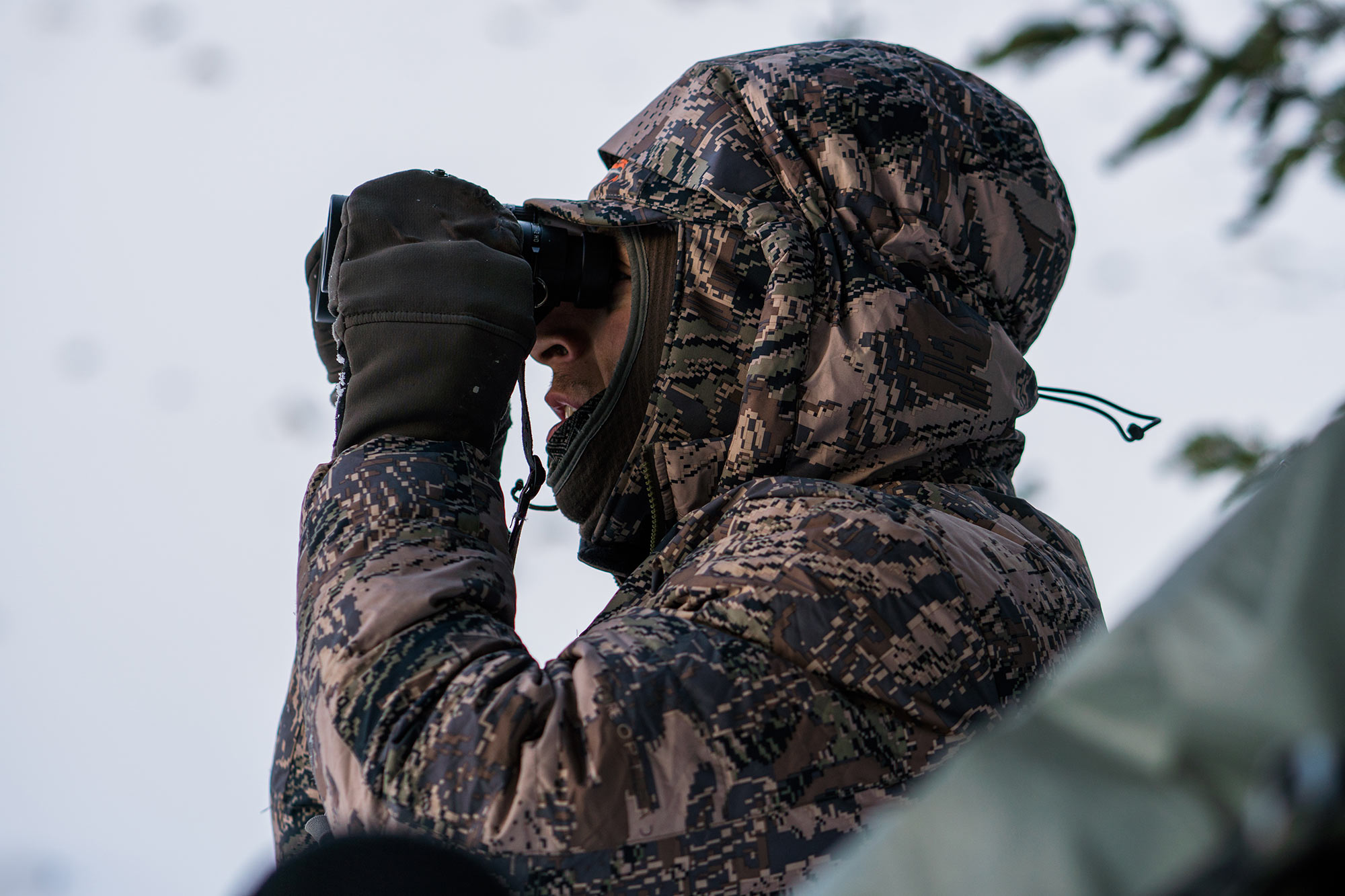 Hunter glasses in the insulated Kelvin Down Hoody.