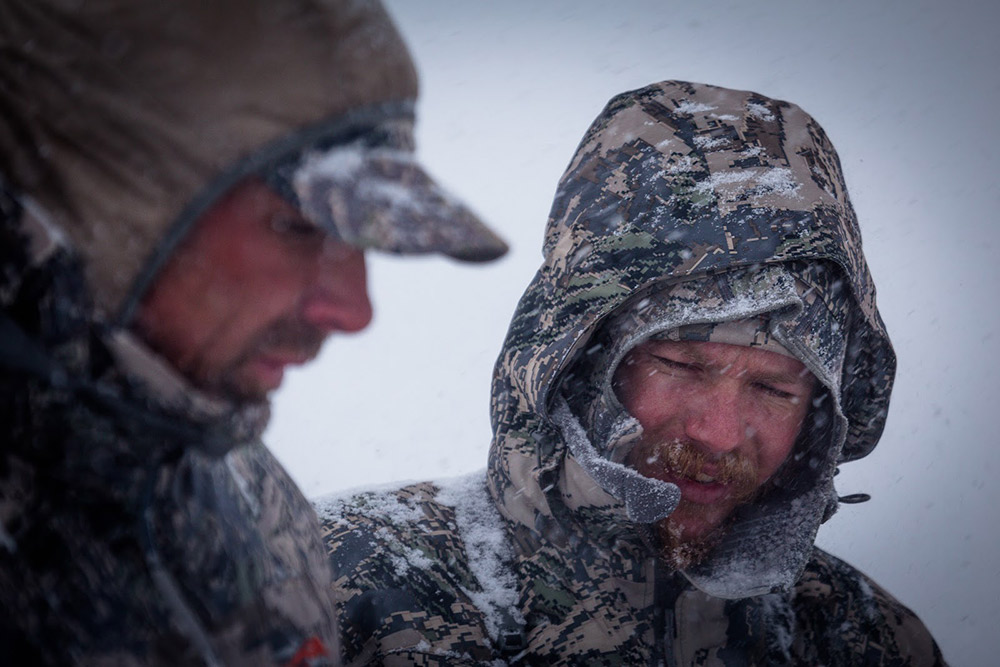 Snow pours down as hunters figure out their next move.