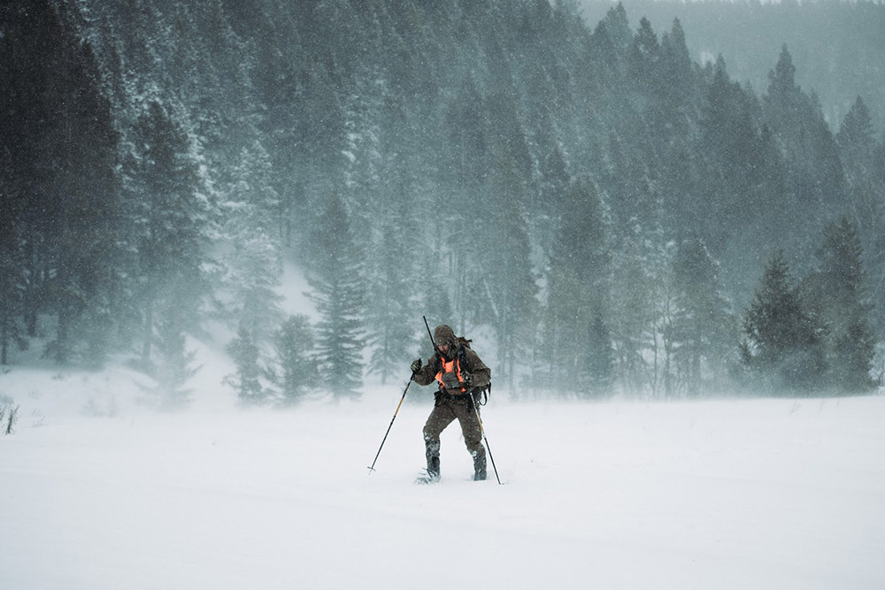 Trekking through snow in late season conditions.