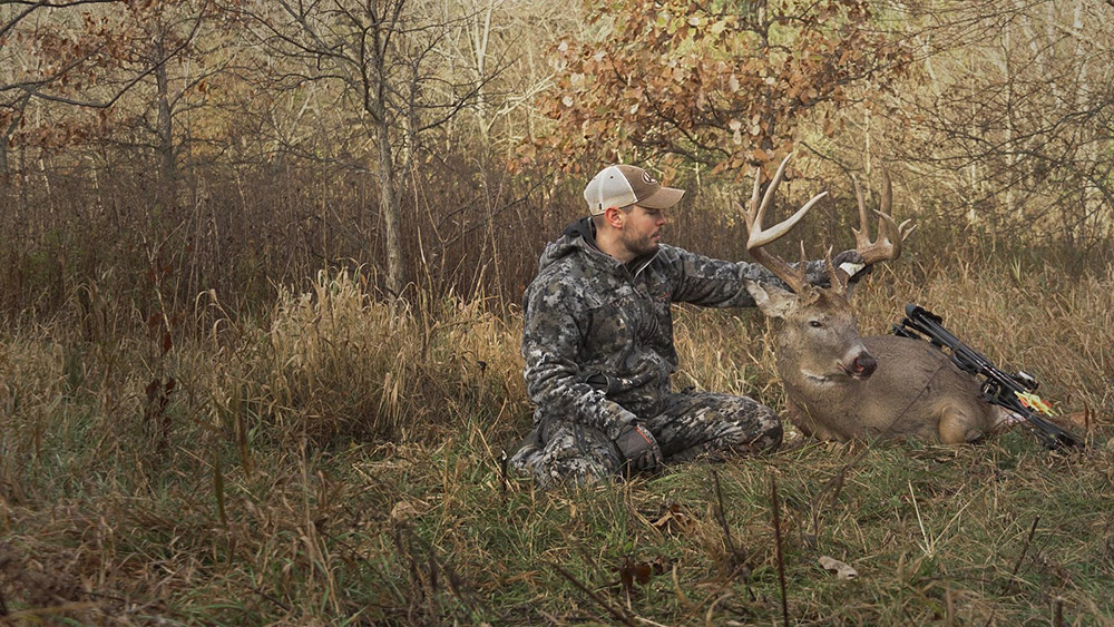 Ben Harshyne of Whitetail Properties harvests a nice buck.