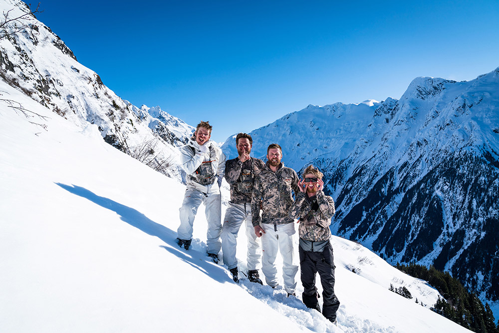 Four hunters posing after vigorous hiking and hunting.