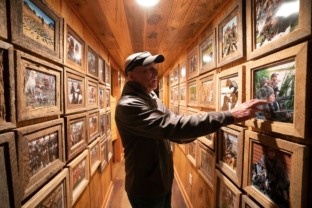 Duck hunter, Ramsey Russell looking at old photos.