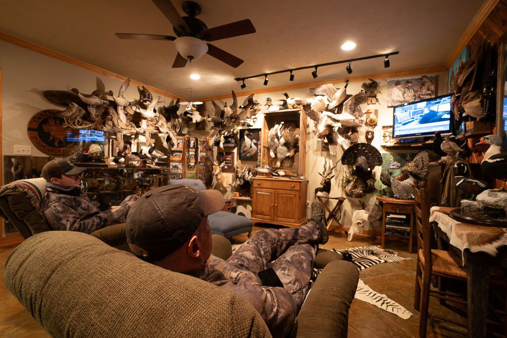 Ramsey Russell relaxes at his duck hunting cabin in Mississippi.