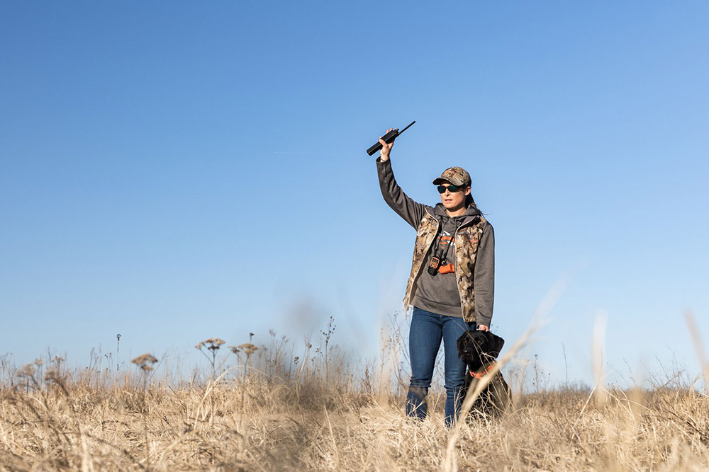Dog trainer Alex Brittingham training a lab for duck hunting.