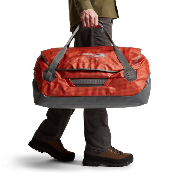 Drifter Duffle 75L in Burnt Orange carrying handles