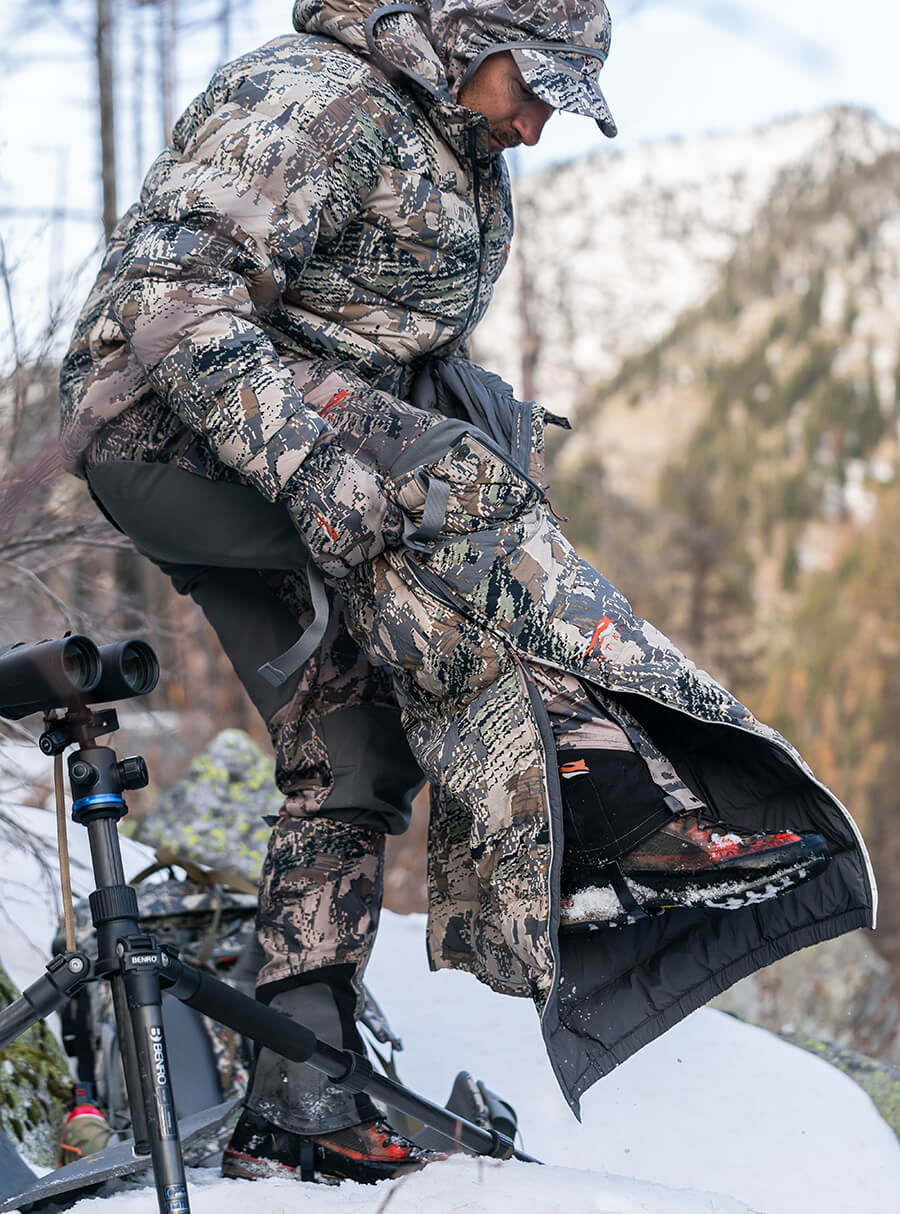 Zipping up the Kelvin Lite Down Pant