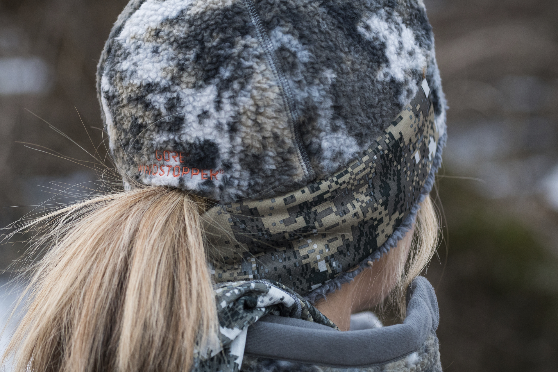 Women's Fanatic Beanie in a tree stand